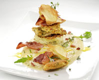 Fish dish, turbot fillets flavored crust, cips, rosti, creamed p. Gourmet fish dish, turbot fillets flavored crust, cips, rosti, creamed potatoes, crispy bacon Royalty Free Stock Photography