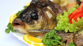 Fish dish with vegetables, stuffed with fish, seafood stock video footage