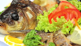 Fish dish with vegetables, stuffed with fish, seafood stock video