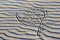 Fish drawn in the sand Royalty Free Stock Image