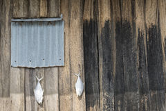 Fish drying outside rustic fisherman house Royalty Free Stock Photos