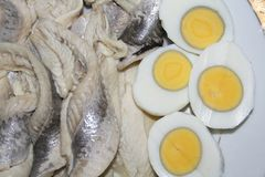 Fish and Eggs. Food on the plate - fish and eggs Stock Image