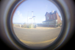 Fish eye effect. Blurry image through a fish eye glass hole in a door Royalty Free Stock Image