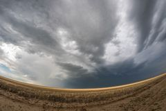 Fish eye lens view of a supercell thunderstorm at the border of the Oklahoma panhandle and northwest Texas. royalty free stock image