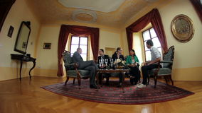 Fish eye shot of a business meeting in an old fashioned office. HD1080p: Fish eye shot of a business meeting in an old fashioned office stock footage