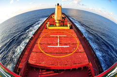Fish-eye view cargo shipping business. Cargo ship bulk carrier crossing ocean fish eye view half circle on top from monkey island Stock Photos