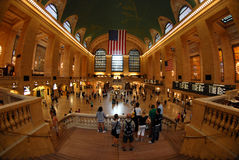 Fish-eye view of Grand Central. A fish-eye view of New York's Grand Central Station. Commuters are milling around the huge station while some people are standing Royalty Free Stock Photography