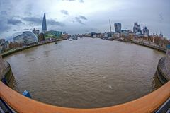 Fish Eye view with London architecture from Tower Bridge. LONDON, ENGLAND - NOVEMBER 27, 2017: Fish Eye view architecture from Tower Bridge and London over river Royalty Free Stock Image