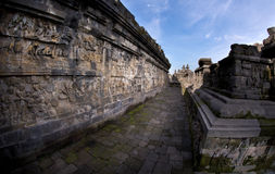 Fish-eye View of Long Ancient Corridor. Fish-eye view of a long ancient corridor at Borobudur Temple, Indonesia Royalty Free Stock Photo