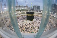 Muslim pilgrims get ready for evening prayer in Makkah, Saudi Arabia. Fish eye view of Muslim pilgrims get ready for evening prayer in Makkah, Saudi Arabia Royalty Free Stock Photography