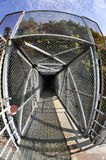 Fish-eye view of an overpass bridge protected by wire netting Stock Images