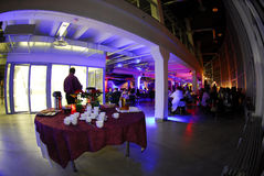 Fish eye view of party. A fish eye view of a dimly lit party area with an overhanging balcony Royalty Free Stock Photo