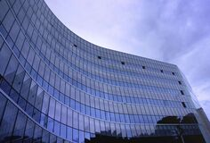 Fish Eye View Photo of Glass High Story Building over White Cloudy Sky during Daytime Stock Photo