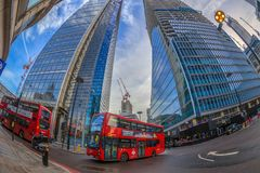 Fish-eye view with red double decker bus and new buildings. Lond. LONDON, ENGLAND - NOVEMBER 27, 2017: Fish-eye view with red double decker bus and new buildings Stock Photo
