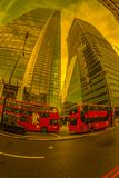 Fish-eye view with red double decker bus and new buildings. Lond. LONDON, ENGLAND - NOVEMBER 27, 2017: Fish-eye view with red double decker bus and new buildings Royalty Free Stock Photo