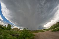 Fish eye view of a supercell thunderstorm over the plains of eastern Wyoming, USA. A severe thunderstorm moves over the landscape of eastern Wyoming. Wallcloud royalty free stock photo