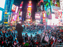 Fish Eye View Times Square. NEW YORK-DECEMBER 5: A fish eye lens view of a crowded Times Square at night on December 5 2013 in New York City stock photo