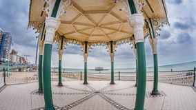 Fish eye view of the Victorian bandstand and the remains of the destroyed West pier in Brighton and Hove Stock Photos
