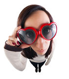 Fish-eyed girl with heart-shaped sunglasses Stock Photography