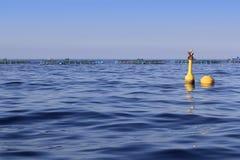 Fish farm on blue ocean sea horizon. Pisciculture royalty free stock photo