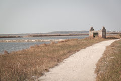 Fish farm path. Lonely house in the fish farm path Royalty Free Stock Image