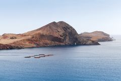 Fish farm sheds in bay of Ponta de Sao Laurenco. Coastal landscape of the municipality of Machico in the Portuguese island of Madeira Royalty Free Stock Images