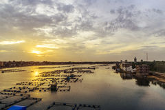 Fish Farms. Over Fresh River Water Under Sunset Royalty Free Stock Images