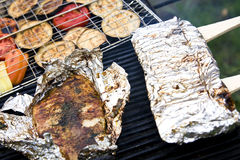 Fish file and vegetables barbecue. Fish file in tinfoil and assorted vegetables barbecue Royalty Free Stock Photo