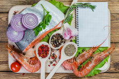 Fish filets and shrimps Stock Photos