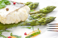 Fish fillet with asparagus foam sauce Royalty Free Stock Photo