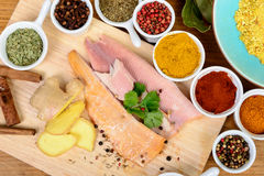 Fish fillet with assortment of spices Stock Photo