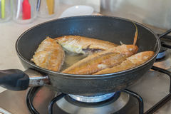 Fish fillet cooking on fry pan, food preparation. Cooking time stock images