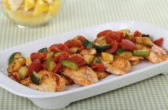 Fish Fillet Dinner. Tilapia fish fillets dinner with lemon slices in background Stock Images