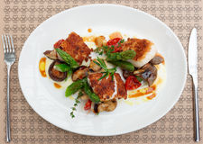 Fish fillet with mushrooms and asparagus Stock Image