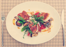 Fish fillet with mushrooms and asparagus, toned Royalty Free Stock Photography