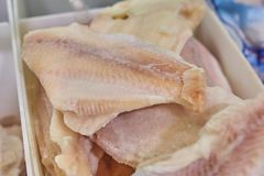 Fish fillet of pangasius in the supermarket fridge. royalty free stock images