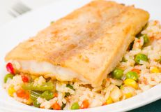 Fish fillet with rice and vegetables Stock Photos