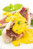 Fish Fillet with Saffron Sauce. As closeup on white plate Stock Images
