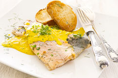 Fish Fillet with Saffron Sauce Stock Photos