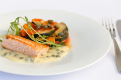 Fish fillet, sauce and vegetables Royalty Free Stock Photos