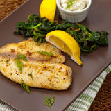 Fish Fillet. Fish with Sauteed Spinach. Selective focus stock images