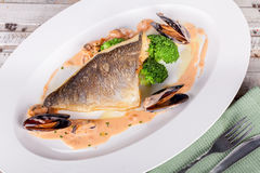 Fish fillet with seafood sauce Royalty Free Stock Images