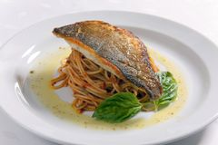 Fish fillet and Spaghetti. Fish fillet with spaghetti, Grilled Halibut with Spaghetti stock image