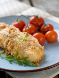 Fish fillet with tomato Stock Images