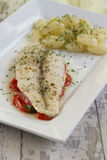 Fish fillet on tomato bed with gnocchi Stock Photo