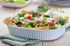 Fish fillet on vegetables Royalty Free Stock Photography