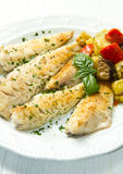Fish fillet with vegetables Stock Photos