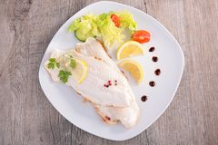 Fish fillet and vegetables Stock Images