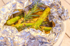Fish fillets cooked with asparagus and potato Stock Images