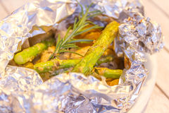 Fish fillets cooked with asparagus and potato Stock Photo
